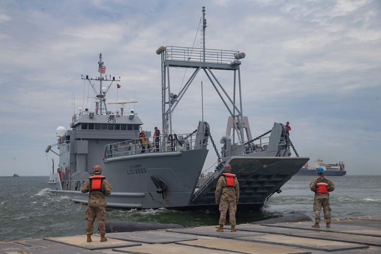 U.S. Army Soldiers with 11th Transportation Battalion, 7th Transportation Regiment prepare for a landing craft, utility to dock on a trident pier during exercise Resolute Sun at Fort Story, Virginia, June 18, 2019. U.S. Marines participated in the exercise to increase combat operational readiness in amphibious and prepositioning operations while conducting joint training with the U.S. Army during a joint logistics over the shore scenario.