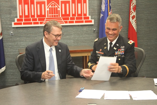 Norfolk City Manager Doug Smith and Col. Patrick Kinsman, commander of Norfolk District, U.S. Army Corps of Engineers, sign the Norfolk Coastal Storm Risk Management design agreement at the Waterfield Building on Fort Norfolk, Virginia, June 28, 2019.