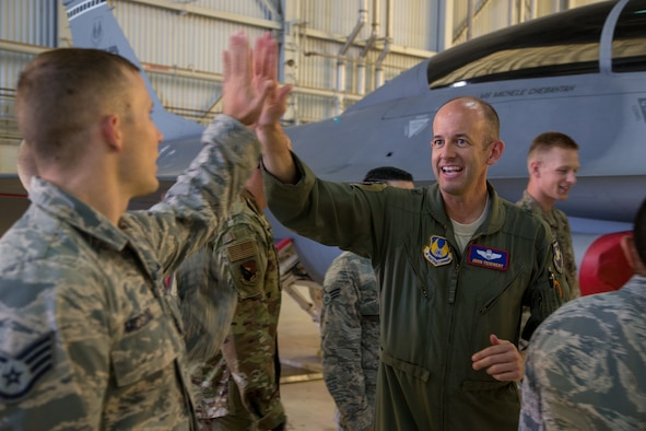 Brig. Gen. E. John Teichert, 412th Test Wing Commander, gives a high-five to a Team Edwards member at Edwards Air Force Base, California, June 18. Teichert and 412th Test Wing Command Chief, Chief Master Sgt. Ian Eishen visited the 412th Maintenance Group Weapons Team to learn about their jobs. (U.S. Air Force photo by Christopher Okula)