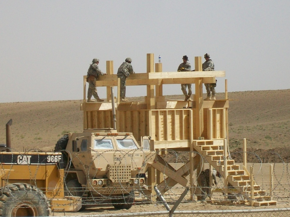 Army personnel building an observation platform in the Middle East using a materials list provided by the Joint Construction Management System (JCMS) database. The JCMS provides lists of materials, construction cost, labor estimates and standards. Army Facilities Component Systems ensure the JCMS remains up to date and can support theater combatant commands and service component commands with construction planning.