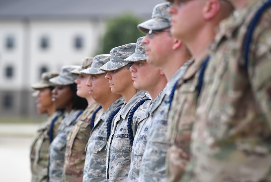 Airmen stand in formation during a Military Training Leader course graduation ceremony at the Levitow Training Support Facility on Keesler Air Force Base, Miss., May 30, 2019. The MTL course is responsible for training approximately 120 MTLs per year. Those MTLs are then responsible for training approximately 30,000 Airmen in 49 different locations that fall under Air Education and Training Command. (U.S. Air Force photo by Kemberly Groue)
