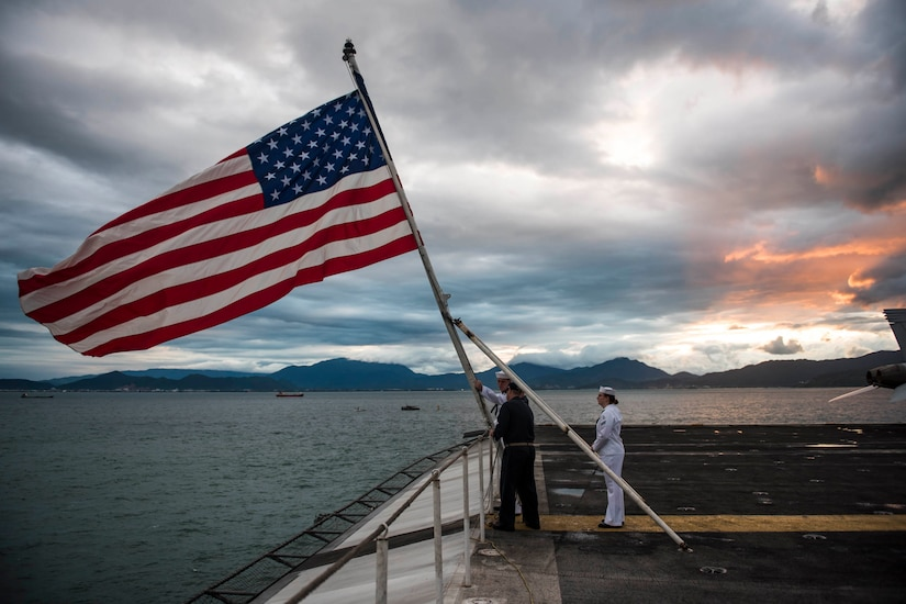 Sailors perform evening colors.