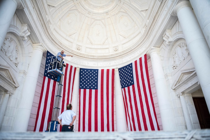 Flags are hung in the Memorial Amphitheater at Arlington National Cemetery.