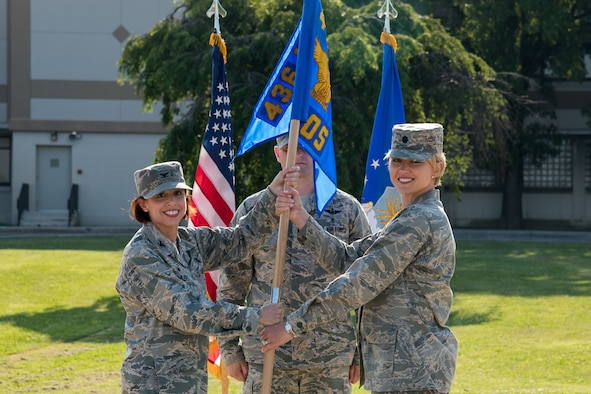 Col. Patricia Fowler, 436th Medical Group commander, hands Lt Col. Lisa Palmer, the guidon of the newly designated 436th Health Care Operations Squadron during a redesignation ceremony June 28, 2019, at the 436th MDG on Dover Air Force Base, Del. Activated in 1992, the 436th MDOS was redesignated as the 436th HCOS, in accordance with the 436th MDG's reorganization as directed by the Secretary of the Air Force's 2019 policy. (U.S. Air Force photo by Roland Balik)
