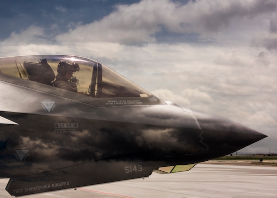 An F-35 Lightning II pilot from Hill Air Force Base, Utah, waits to taxi onto the runway June 20, 2019, at Mountain Home Air Force Base, Idaho. This double exposure photo was captured in camera by combining two perspectives, a photo of the F-35 and photo of the sky, to create a singular image. (U.S. Air Force photo by Airman 1st Class Andrew Kobialka)