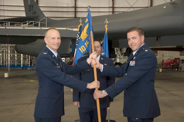 Lt. Col. James T. Couch takes the guidon of the 10th Flight Test Squadron from Col. Christopher M. Zidek, commander of the 413th Flight Test Group, Air Force Reserve Command, during a change of command ceremony June 28, 2019, Tinker Air Force Base, Oklahoma. The 10th FLTS is responsible for post-depot maintenance test flights of B-1, B-52, E-3 and KC-135 aircraft in support of the Oklahoma City Air Logistics Complex, Air Force Materiel Command.  (U.S. Air Force photo/Greg L. Davis)