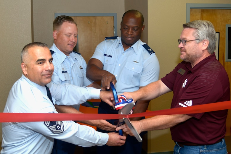 U.S. Air Force Col. Leo Lawson Jr., previous 81st Training Group commander, cuts a ribbon with 334th Training Squadron leadership at Cody Hall, on Keesler Air Force Base, Mississippi, June 28, 2019. The 334th TRS incorporated a VR classroom for a more efficient and visual way of teaching Airfield Maintenance. (U.S. Air Force photo by Airman Seth Haddix)