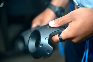 An Airman from the 334th Training Squadron tries out new virtual reality technology of the 334th TRS at Cody Hall, on Keesler Air Force Base, Mississippi, June 28, 2019. The 334th TRS incorporated a VR classroom to teach Airfield Maintenance more efficiently with visual simulation. (U.S. Air Force photo by Airman Seth Haddix)