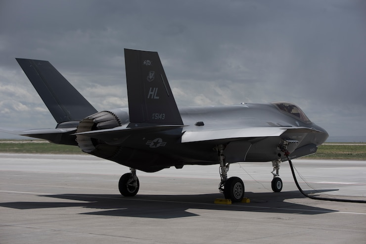 An F-35 Lightning II from Hill Air Force Base, Utah, refuels with a hose cart from the 1970s in a hot-pit on June 20, 2019, at Mountain Home Air Force Base, Idaho. A hot-pit allows aircraft to refuel without turning the engine off and quickly return to the air. The traditional refueling process can take more than an hour before the aircraft can take off, while a hot-pit takes 13 minutes. (U.S. Air Force photo by Airman First Class Andrew Kobialka)