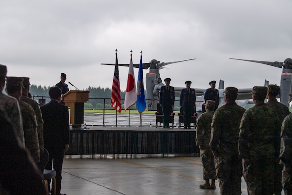 Master Sgt. Andrew Banta, master of ceremonies, announces the departing of the official party during the assumption of command ceremony at Yokota Air Base, Japan, July 1, 2019.