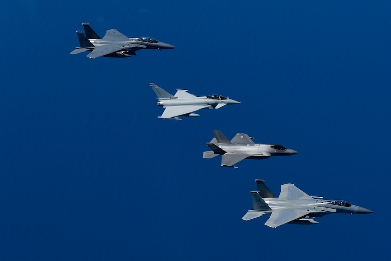 U.S. Air Force fourth and fifth-generation aircraft fly in an echelon formation with a Royal Air Force Typhoon in support of exercise Pointblank 19-2, over the North Sea, June 27, 2019. The objective of the exercise is to prepare coalition warfighters for a highly contested fight against near-peer adversaries by providing a multi-dimensional battle-space to conduct advanced training in support of US, UK and French national interests. (U.S. Air Force photo/ Tech. Sgt. Matthew Plew)