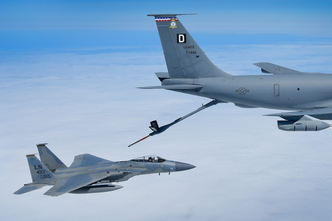An F-15C Eagle assigned to the 493rd Fighter Squadron conducts in-flight refueling operations with a KC-135 Stratotanker from the 100th Air Refueling Wing in support of exercise Pointblank 19-2, over the North Sea, June 27, 2019. The objective of the exercise is to prepare coalition warfighters for a highly contested fight against near-peer adversaries by providing a multi-dimensional battle-space to conduct advanced training in support of US, UK and French national interests. (U.S. Air Force photo/ Tech. Sgt. Matthew Plew)