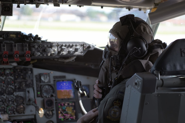 U.S. Air Force 1st Lt. Kelly Hightaian, 351st Air Refueling Squardron co-pilot, dons her gas mask before supporting Exercise Point Blank at RAF Mildenhall, England, June 27, 2019. Military training and exercises with allies and partners is vital to our operational readiness and capability to respond anytime, anywhere. (U.S. Air Force photo by Senior Airman Benjamin Cooper)