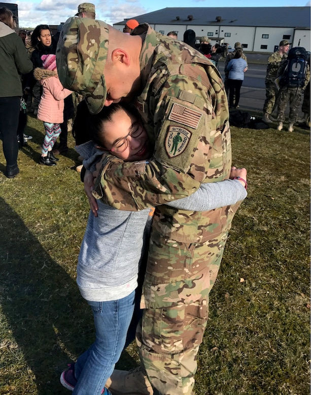 U.S. Air Force Master Sgt. Richard Duken, first sergeant of the 57th Rescue Squadron from Aviano Air Base, Italy, hugs his daughter. (Courtesy Photo)
