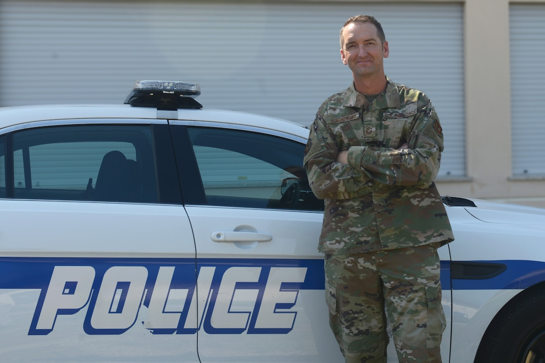 U.S. Air Force Senior Master Sgt. Jeremy Schoneboom, first sergeant of the 31st Security Forces Squadron poses for a photo next to a vehicle at Aviano Air Base, Italy, June 26, 2019. The 31st Security Forces Squadron maintains installation force protection during peacetime and wartime operations within eight separate base areas. (U.S. Air Force photo by Airman 1st Class Ericka A. Woolever).