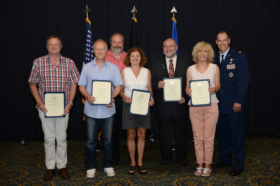 Recipients of the Civilian Length of Service award stand with U.S. Air Force Col. Matthew Husemann, 86th Airlift Wing vice commander, for a group photo during a ceremony on Ramstein Air Base, Germany, June 27, 2019. The recipients served 40 years of continued service to the U.S. Armed Forces. (U.S. Air Force photo by Airman 1st Class Jennifer Gonzales)