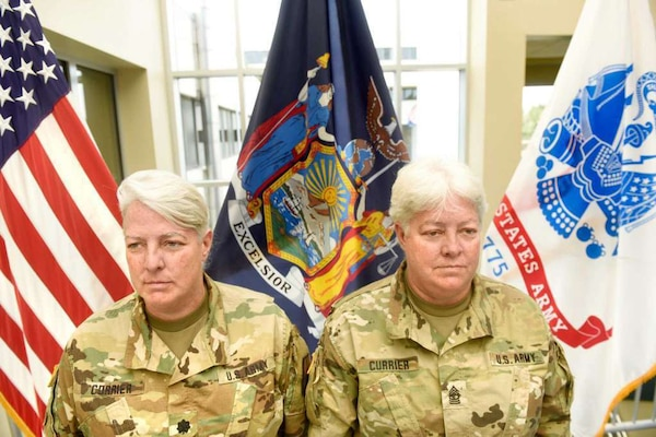 Lt. Col. Lynn Currier, an information management branch manager, and Master Sgt. Lisa Currier, a senior logistics officer, assigned to the New York National Guard Headquarters, prepare for Lynn's retirement from the New York National Guard during a ceremony last month in Latham, N.Y. The two sisters began their military careers together in 1986 when they enlisted into the Vermont Army National Guard before transferring to the New York National Guard in the early 1990s.