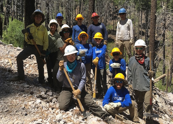 Youth Conservation Corps crew members and US Forest Service staff pose for a group photo in the Coronado National Forest in southern Arizona.