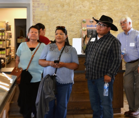 Attendees of a tribal conference hosted by Joint Base San Antonio view an exhibit at the Fort Sam Houston Museum at JBSA-Fort Sam Houston June 25. Representatives of three federally recognized Native American tribes attended the conference, whose purpose was to establish relations and to discuss issues and topics of concern between the tribes and JBSA officials.