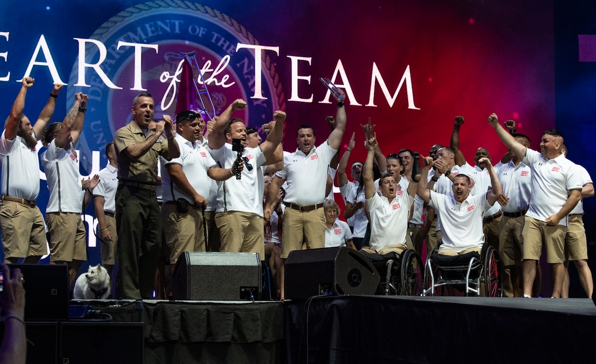 """U.S. Marine Corps Gunnery Sgt. Raymond Archer is awarded the """"Heart of the Team"""" award at the 2019 DoD Warrior Games closing ceremony in Tampa, Florida, June 30. Lt. Gen. Michael Rocco, Deputy Commandant for Manpower and Reserve Affairs, presented the award. The DoD Warrior Games were established in 2010 as a way to enhance the recovery and rehabilitation of wounded, ill or injured service members and veterans and to expose them to adaptive sports."""