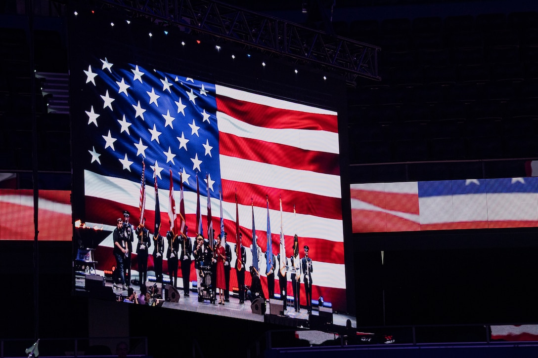 The National Anthem is played at the 2019 DoD Warrior Games closing ceremony at Amalie Arena, Tampa, Florida, June 30, 2019. The Warrior Games showcase the resilient spirit of today's wounded, ill or injured service members from all branches of the military and provide a venue for recovering service members and veterans to demonstrate triumph over significant physical or invisible wounds and injuries.