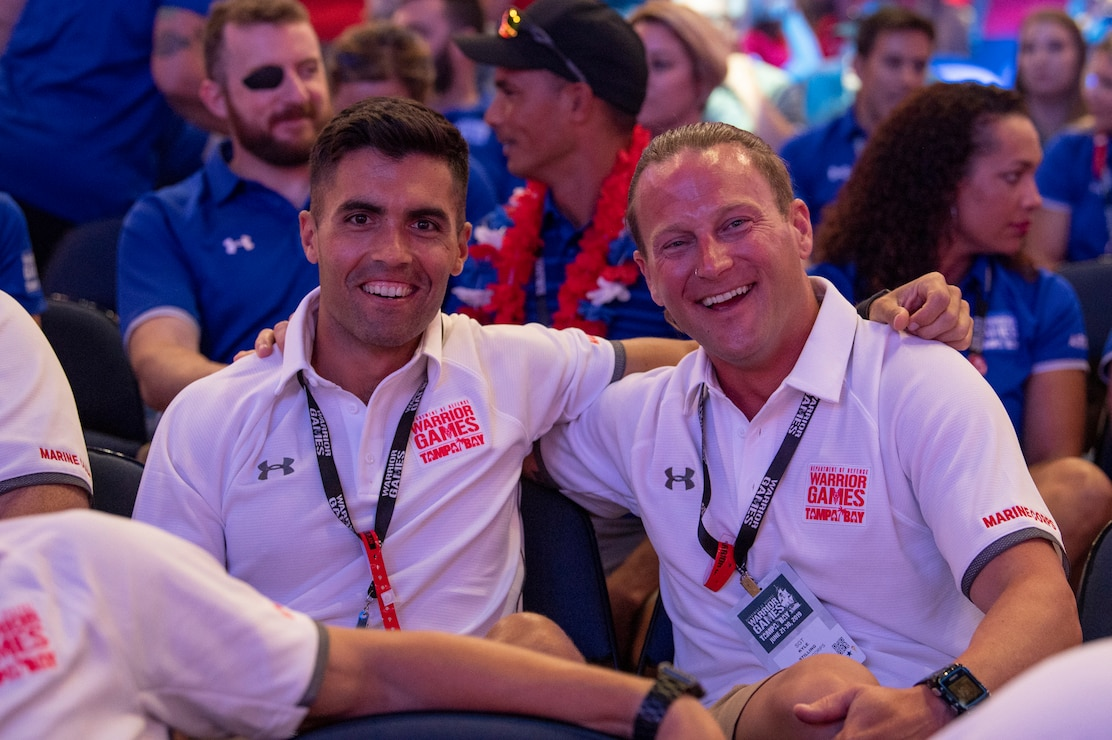 U.S. Marine Corps Capt. Patrick Nugent and veteran Kyle Stilling celebrate at the 2019 Warrior Games closing ceremony at Amalie Arena in Tampa, Florida, June 30. The Warrior Games showcase the resilient spirit of today's wounded, ill or injured service members from all branches of the military and provide a venue for recovering service members and veterans to demonstrate triumph over significant physical or invisible wounds and injuries.