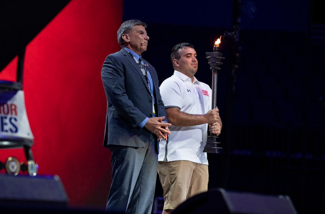Maj. Gen. Juan Ayala (Ret.), City of San Antonio Director  of Military Affairs  and Cpl. Matthew Maddux, the Ambassador for the 2020 Warrior Games, present the torch on stage after receiving it from U.S. Special Operations Command. Next year's games will be hosted by the U.S. Marine Corps in San Antonio, Texas. The Warrior Games showcase the resilient spirit of today's wounded, ill or injured service members from all branches of the military and provide a venue for recovering service members and veterans to demonstrate triumph over significant physical or invisible wounds and injuries.