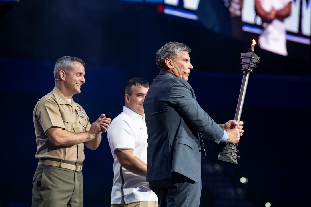 The 2019 DoD Warrior Games end with the passing of the torch at the game's closing ceremony at Amalie Arena, Tampa, Florida, June 30, 2019. Lt. Gen. Michael Rocco, Deputy Commandant for Manpower & Reserve Affairs,  received the torch with Maj. Gen. Juan Ayala (Ret), City of San Antonio Director of Military Affairs, to signify the Marine Corps' partnership with San Antonio.. Next year's games will be hosted by the U.S. Marine Corps in San Antonio, Texas. The DoD Warrior Games were established in 2010 as a way to enhance the recovery and rehabilitation of wounded, ill or injured service members and veterans and to expose them to adaptive sports.