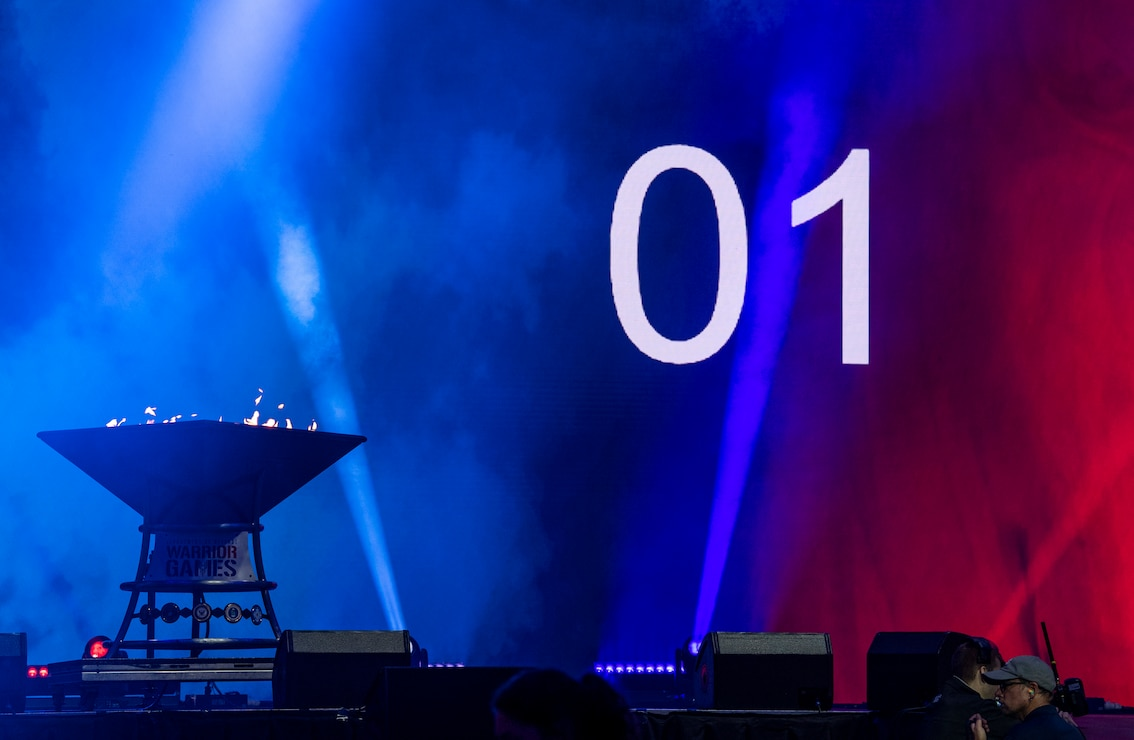 The count down to the closing ceremony comes to an end as the cauldron burns on stage at the 2019 DoD Warrior Games closing ceremony at Amalie Arena, Tampa, Florida, June 22, 2019. The 2019 Warrior Games consist of 13 Paralympic-style sports, and more than 300 athletes representing the U.S. Marine Corps, Army, Navy, Air Force, Special Operations Command, and five international teams.