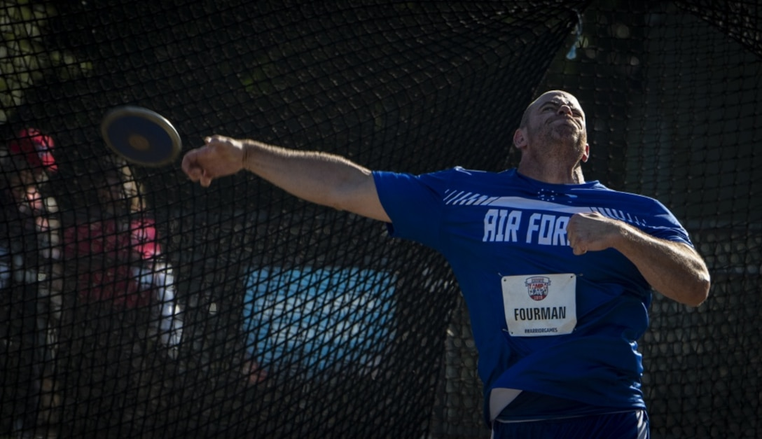U.S. Air Force Tech. Sgt Steve Fourman, Team Air Force athlete, hurls a discus during the Department of Defense Warrior Games field competition in Tampa, Fla., June 23, 2019. Warrior Games athletes have overcome significant physical and psychological challenges, not always visible to others and have demonstrated that life continues after becoming wounded, ill or injured. (U.S. Air Force photo by Staff Sergeant James R. Crow)