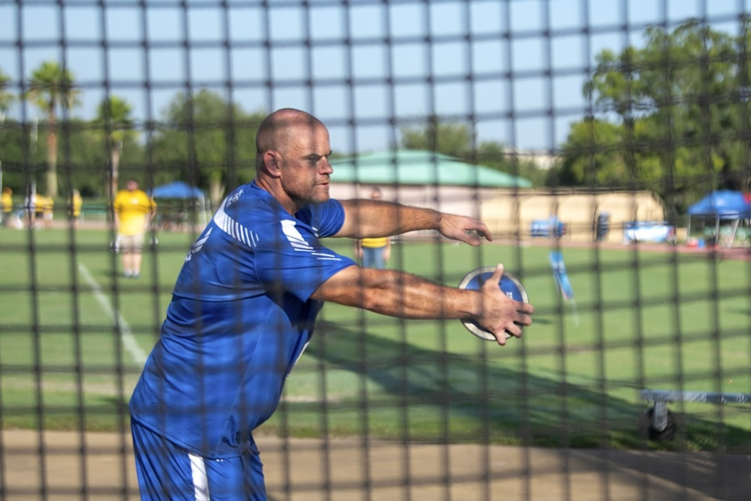 U.S. Air Force wounded warrior athlete Technical Sgt. Steve Fourman prepares to throw a discus during the discus field event at the Department of Defense Warrior Games in Tampa, Fla., June 23, 2019. The Warrior Games features wounded warrior athletes who compete in multiple sporting events representing their respective military branches. (U.S. Air Force photo by Senior Airman Caleb Nunez)