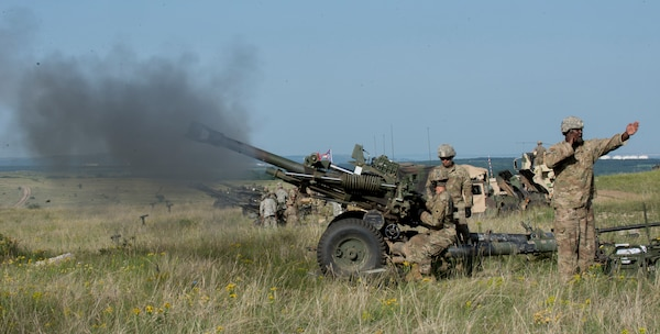 Soldiers with Battery A, 1st Battalion, 134th Field Artillery Regiment, Ohio Army National Guard, conduct live-fire artillery training with their M119A3 howitzer June 12, 2019, near Varpalota, Hungary. The units participated in Breakthrough 19, a Hungarian national training exercise that utilized multiple artillery systems from the Hungarian Defence Forces, U.S. Army Europe and Army National Guard units to create a collective capability that increases the interoperability and readiness of the participating militaries.