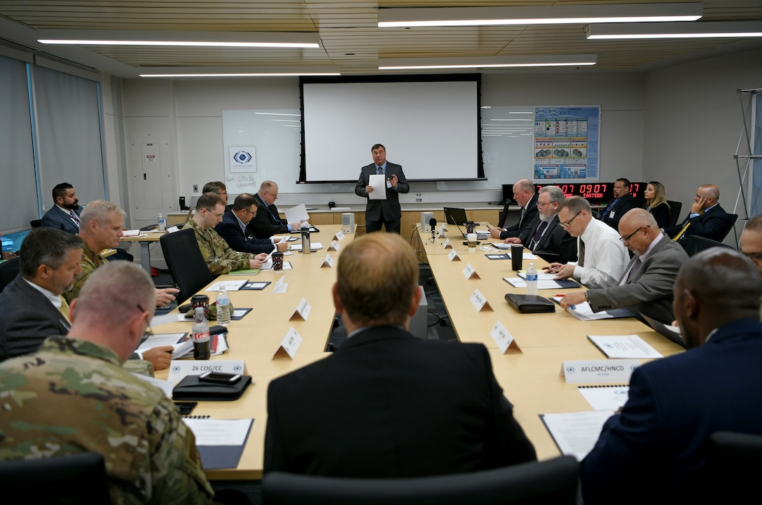 Jerry Thompson, 24th Air Force Cyber Proving Ground operations lead, greets Air Force cyber leaders for the first-ever, 24th AF-hosted Enterprise Data Loss Prevention Solution Summit in San Antonio, Texas, on June 26, 2019. Throughout the event attendees discussed solutions to meet EDLP requirements and overcome challenges, all aimed at presenting a more disciplined, ready and lethal cyber force. (U.S. Air Force photo by Tech. Sgt. R.J. Biermann)