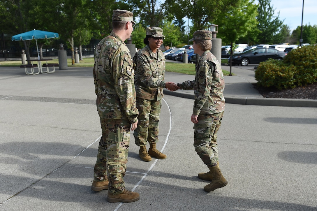 Col. Robert McCoy, 62nd Medical Squadron commander, and Senior Master Sgt. Michelle Joseph, 62nd MDS superintendent, greet Gen. Maryanne Miller, Air Mobility Command commander, June 26, 2019, in front of the 62nd MDS on Joint Base Lewis-McChord, Wash.
