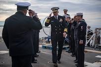 Adm. Craig S. Faller, commander, U.S. Southern Command, is welcomed aboard USS Michael Murph.