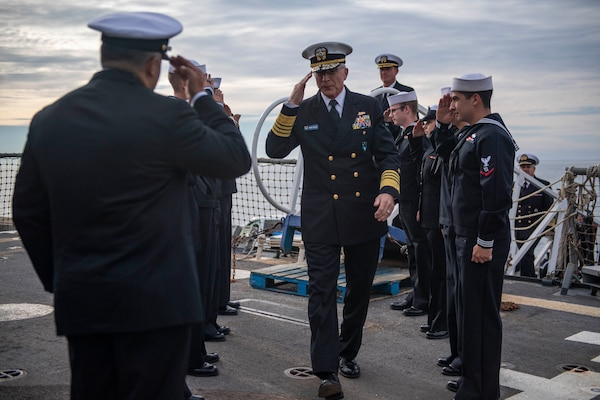 Adm. Craig S. Faller, commander, U.S. Southern Command, is welcomed aboard USS Michael Murph.