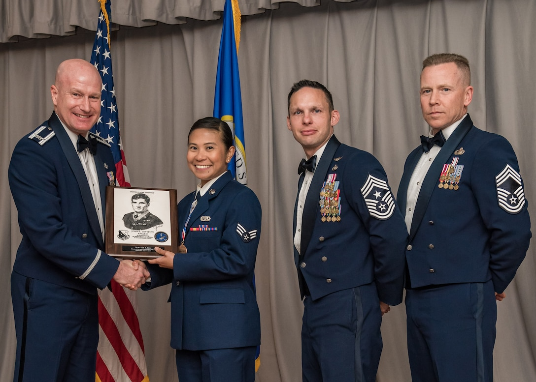 Senior Airman Leah Lira, 452nd Maintenance Squadron, out of March Air Reserve Base, receives the John L. Levitow Award during a graduation ceremony for Airman Leadership Class 19E at Edwards Air Force Base, California, June 27. The Levitow Award is the highest award presented at ALS.(U.S. Air Force photo by Matthew Williams)