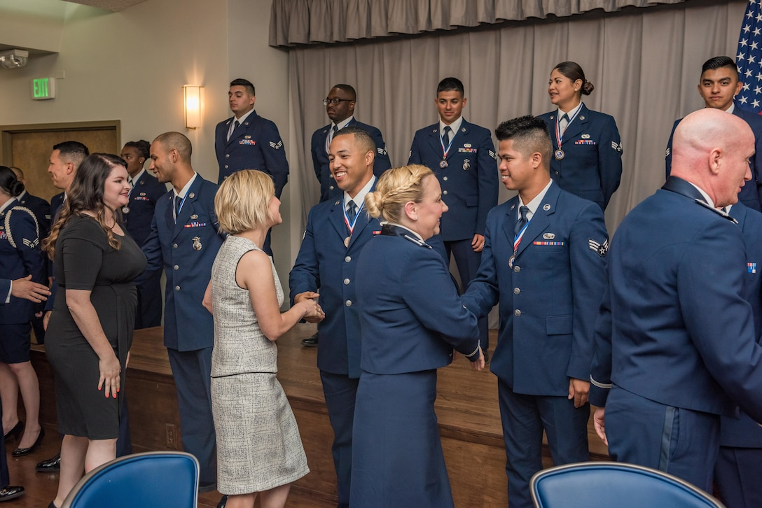 Family, friends and colleagues congratulate members of Airman Leadership School Class 19E at Edwards Air Force Base, California, June 27. (U.S. Air Force photo by Matthew Williams)