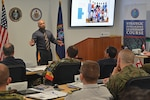 Mubin Shaikh shared with DIA's Strategic Intelligence Leadership Course his story of being a reformed extremist, who helped dismantel terrorist cells. (Photo by Ally Rogers, OCC)