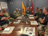 Air Force Conventional Forces Coordinator and Director of Operations, Headquarters Air Combat Command, Joint Base Langley-Eustis, Va., Air Force Maj. Gen. Kevin Huyck is briefed by the top leaders at Joint Task Force Civil Support (JTF-CS) during a visit to the command's headquarters. JTF-CS employs conventional Air Force forces such as the Air Force Radiological Assessment Team, combat camera, the Expeditionary Medical Support (EMEDS), and the Rapid Engineer Deployable Heavy Operational Repair Squadron Engineers (REDHORSE). When directed, JTF-CS is ready to respond in 24 hours to provide command and control of 5,200 federal military forces located at more than 36 locations throughout the nation in support of civil authority response operations to save lives, prevent further injury and provide critical support to enable community recovery. (Official DoD photo by Lt. Col. Karen Roganov/released)