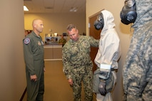 Air Force Conventional Forces Coordinator and Director of Operations, Headquarters Air Combat Command, Joint Base Langley-Eustis, Va., Air Force Maj. Gen. Kevin Huyck is briefed by Navy Chief Petty Officer Benjamin Allen on the Blauer BRN-94 ensemble, which is the main personal protective equipment (PPE) used at Joint Task Force Civil Support (JTF-CS), during a visit to the command's headquarters. JTF-CS employs conventional Air Force forces such as the Air Force Radiological Assessment Team, combat camera, the Expeditionary Medical Support (EMEDS), and the Rapid Engineer Deployable Heavy Operational Repair Squadron Engineers (REDHORSE). When directed, JTF-CS is ready to respond in 24 hours to provide command and control of 5,200 federal military forces located at more than 36 locations throughout the nation in support of civil authority response operations to save lives, prevent further injury and provide critical support to enable community recovery. (Official DoD photo by Mass Communication Specialist 3rd Class Michael Redd/released)