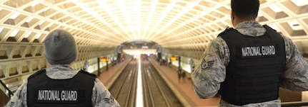 District of Columbia National Guardsmen keep a watchful eye in the McPherson Square Metro Station. (U.S. Army National Guard photo by Staff Sgt. G.H. Cureton)