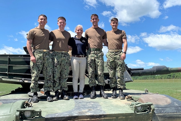 Program Executive Officer Land Systems introduced midshipmen from the U.S. Naval Academy, pictured on an M1A1 Abrams tank in June 2019, to the military acquisition process through the summer PEO LS Internship Program. The program was established in 2013 as a way to introduce cadets and midshipmen from the U.S. Military Academy and USNA to the world of Marine Corps acquisition. (Courtesy photo)