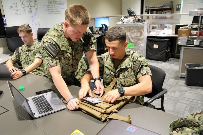 Midshipmen selected for the the Program Executive Officer Land Systems 2019 Internship Program demonstrate work on developing a 3D-printed navigation board prototype for Marines. The program was established in 2013 as a way to introduce cadets and midshipmen from the U.S. Military Academy and USNA to the world of Marine Corps acquisition. (U.S. Marine Corps photo by Ashley Calingo)