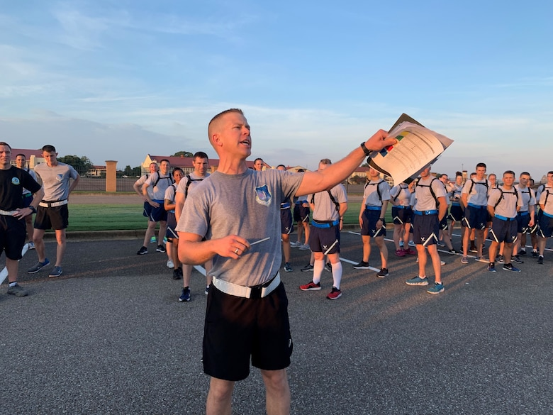Capt. Dan Hochhalter, Officer Training School instructor, shouts to trainees during a physical training session at Maxwell Air Force Base, Alabama.