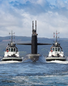 HER MAJESTY'S NAVAL BASE CLYDE, Scotland (July 2, 2018) The Ohio-class ballistic missile submarine USS Alaska (SSBN 732) arrives at Her Majesty's Naval Base Clyde, Scotland, for a scheduled port visit July 2, 2019. The port visit strengthens cooperation between the United States and United Kingdom, and demonstrates U.S. capability, flexibility, and continuing commitment to NATO allies.