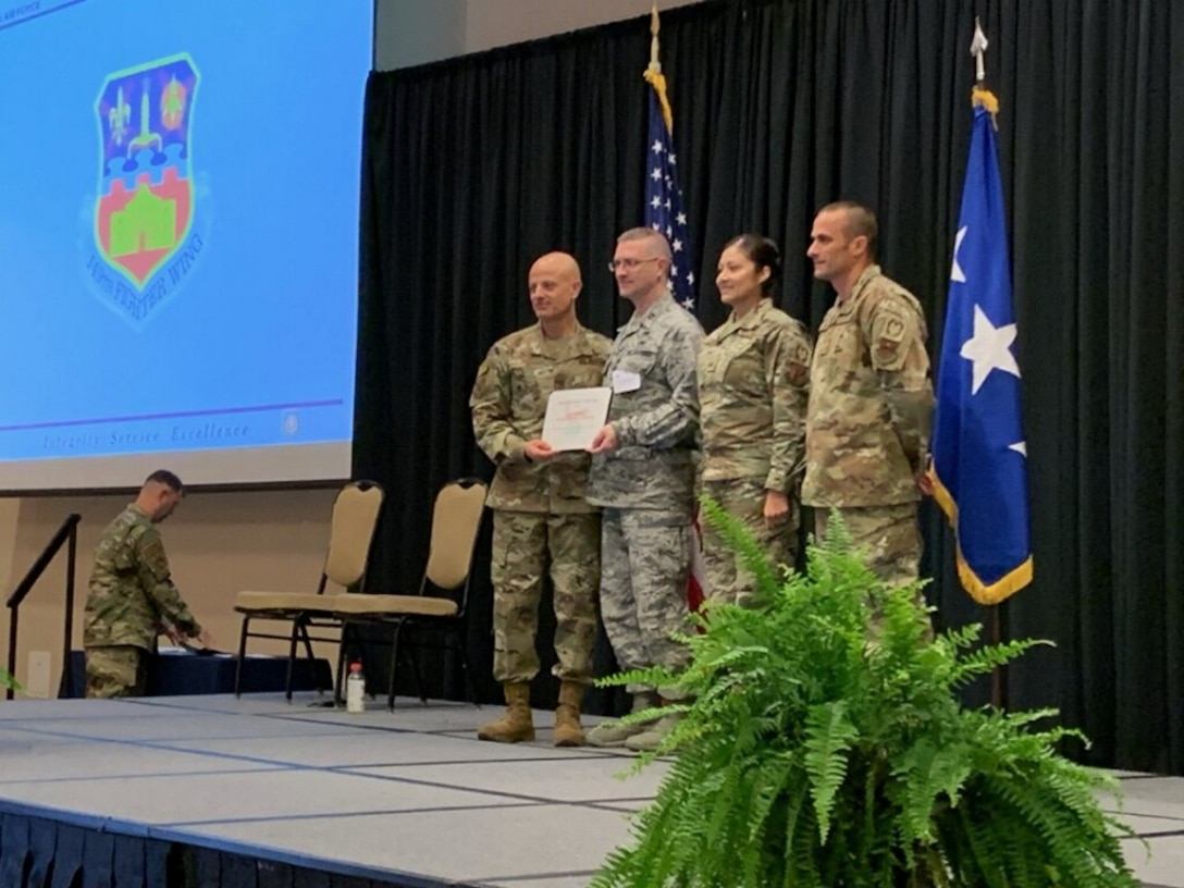 149 IG team receives award from the AETC commander.