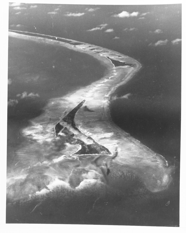 The Z-shaped Tarawa Atoll is seen from the sky with ocean all around it.