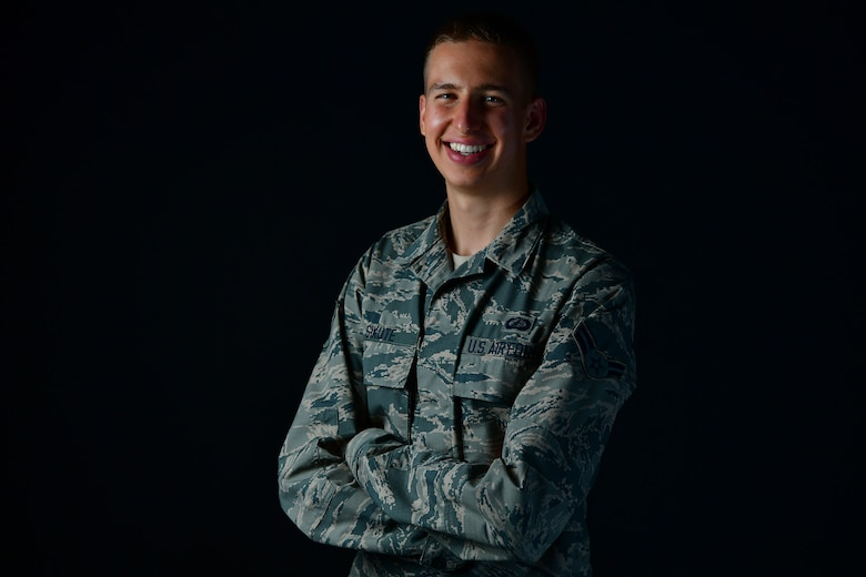 An Airman poses for a photo in the studio.
