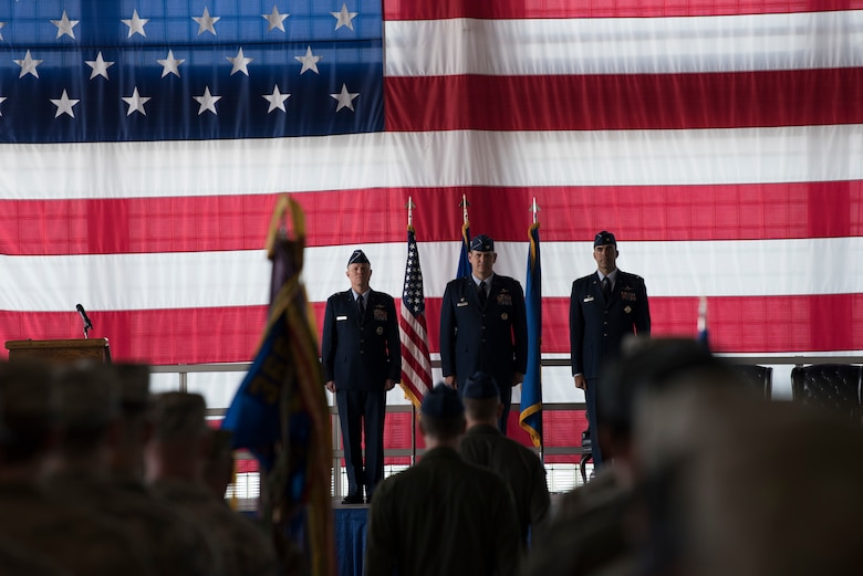 Maj. Gen. Andrew Croft, 12th Air Force (Air Forces Southern) commander, Col. Joe Kunkel, former 366th Fighter Wing commander, and Col. Richard Goodman, 366th FW commander, stand at attention during the 366th FW change of command ceremony July 2, 2019, at Mountain Home Air Base, Idaho. Croft presided over the ceremony where Goodman took command of the 366th FW from Kunkel. (U.S. Air Force photo by Airman First Class Andrew Kobialka